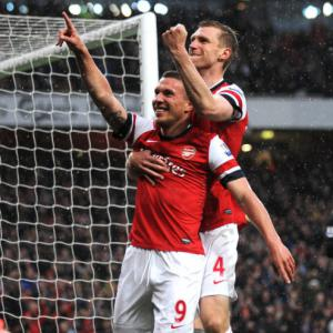 Podolski double condemns Wigan to relegation