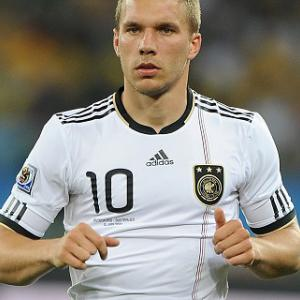 Podolski nets two in Arsenal win