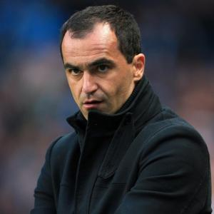 Wigan boss Roberto Martinez respects Carroll qualities