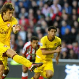 Rosicky sorry for penalty blunder