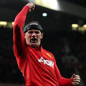 Carrick hails 'sharp' Rooney