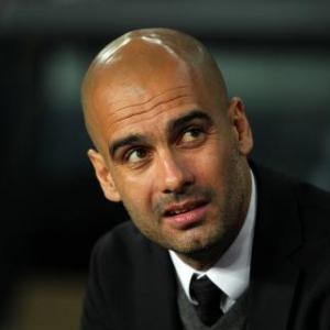 Berlusconi  admits AC Milan are chasing Guardiola