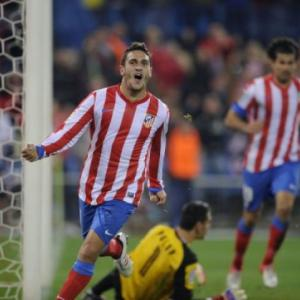 Atletico thrash Sevilla to keep pressure on Barca