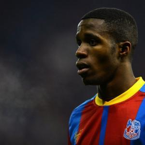 Man Uniteds Zaha charged over rude gesture