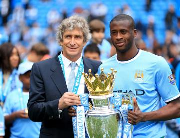 Pellegrini: Toure's happy at City