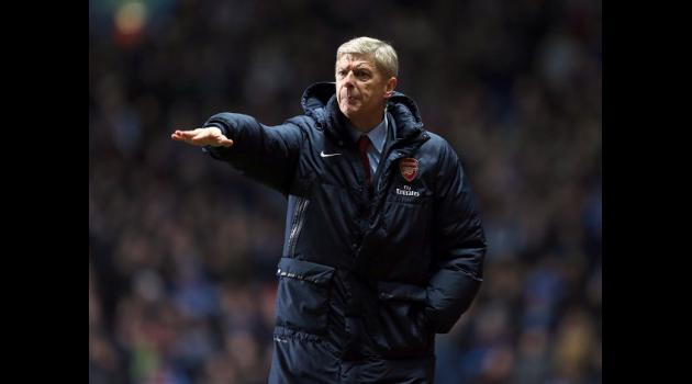Wenger ignores Man City hype