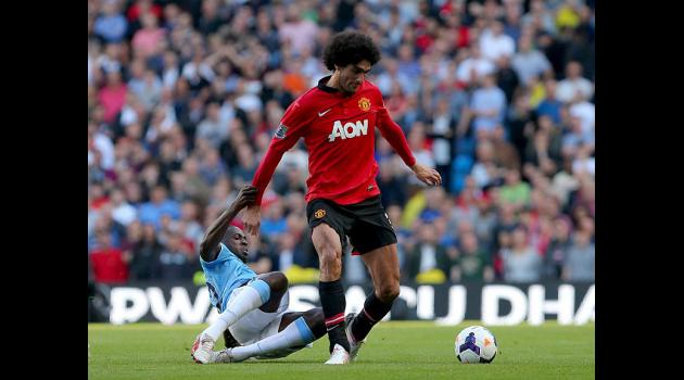 Neville backs Fellaini to shine