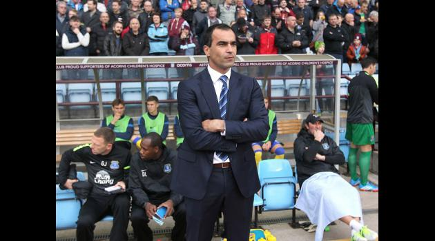 Martinez plays down top-four talk