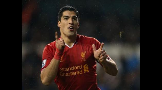 Rodgers gives Suarez full backing