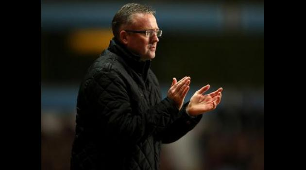 Lambert defends stance after defeat