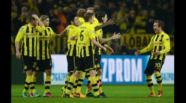 Dortmund crush Shakhtar to reach last eight