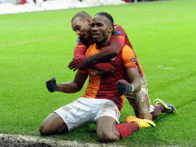 Late Sneijder goal sinks Juventus, sending Galatasaray to last 16