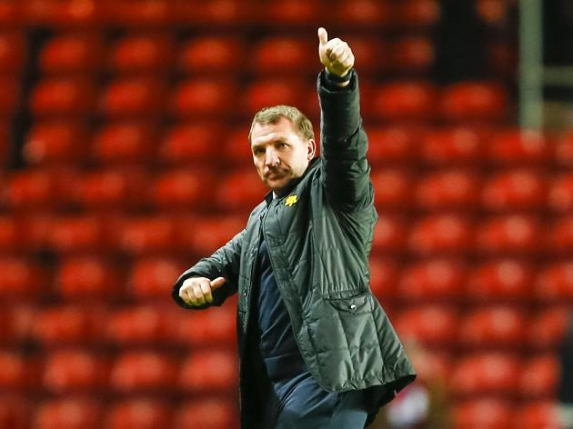 Rodgers plays down title talk