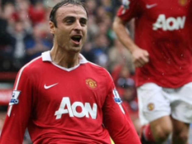 Berbatov bags treble to save United