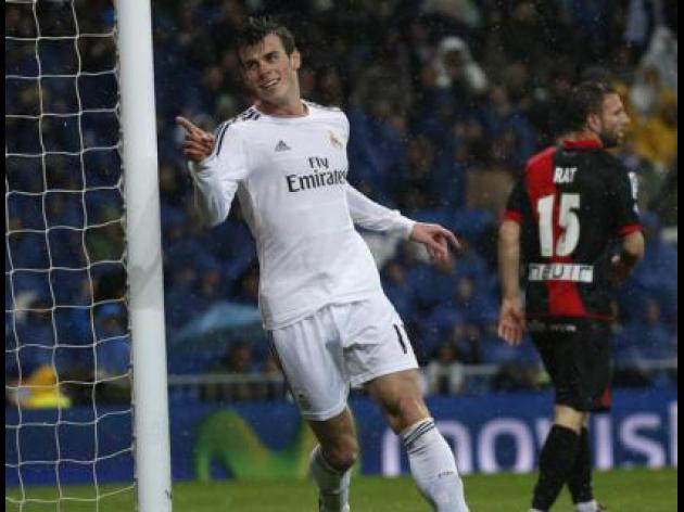 Bale beauty keeps Madrid on Atletico, Barcas tails