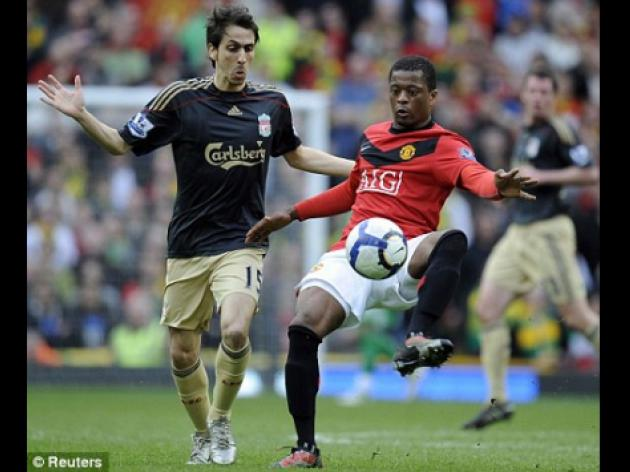 Manchester United's Patrice Evra driven by Barcelona defeat
