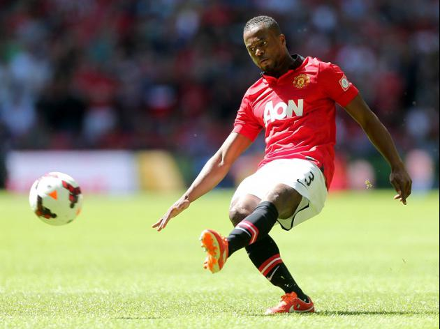 Evra signs new United deal