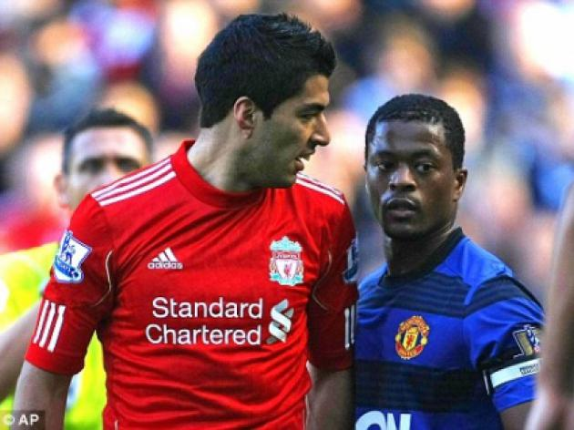 Luis Suarez charged over Patrice Evra racism row