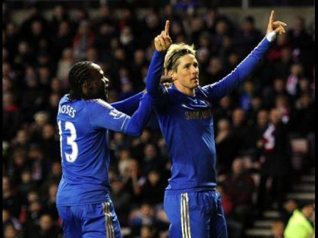Benitez says Fernando Torres is smiling again now he's scoring for Chelsea