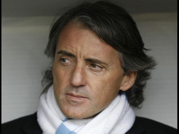 Mancini committed to Manchester City