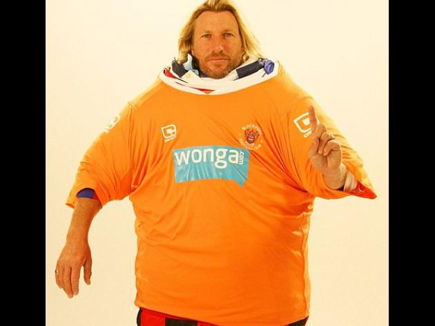 Robbie Savage attempts world record for most football shirts worn