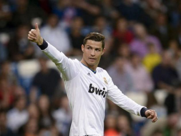 Ronaldo hits 200 as Real keep Barca waiting