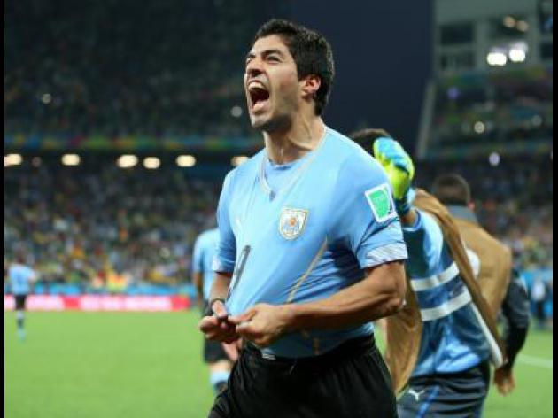 Suarez double shatters England as Uruguay win