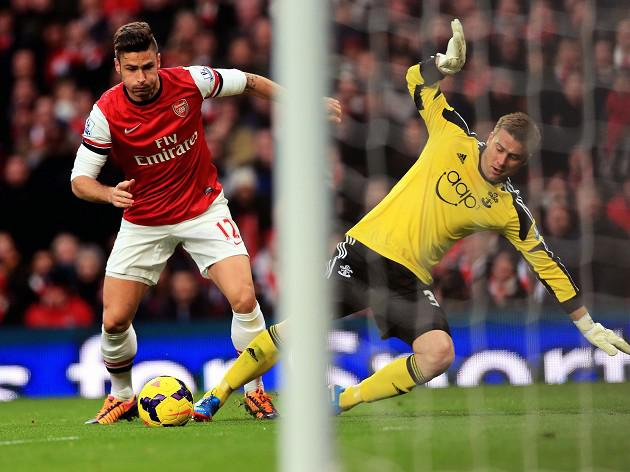 Boruc error helps Gunners stay top