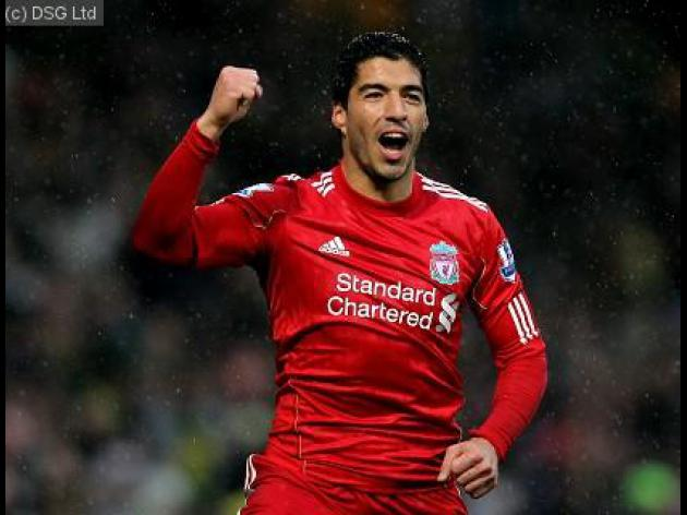 Suarez agrees new Liverpool deal