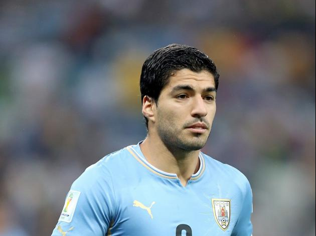 Suarez row overshadows Uruguay win