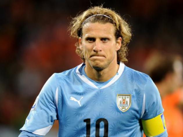 Digestive problem keeps Forlan out of training