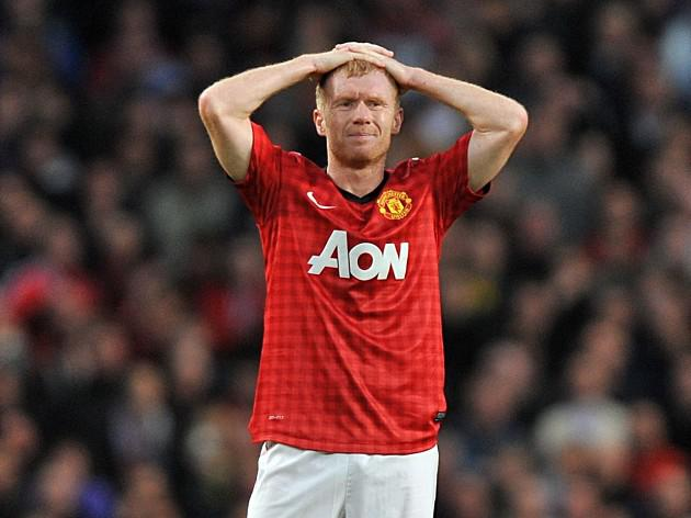 Manchester United midfielder Paul Scholes out for two weeks