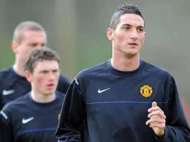 Manchester United player Federico Macheda robbed