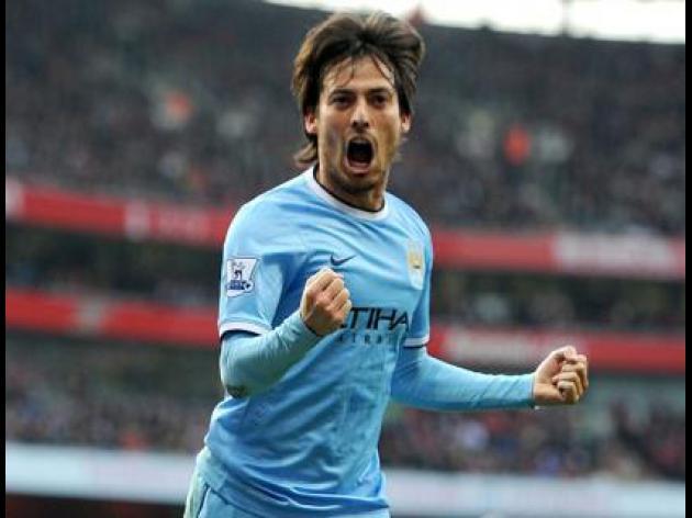 Silva signs new City deal