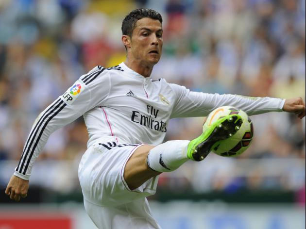 Free-scoring Real Madrid in pursuit of Barca, Atletico