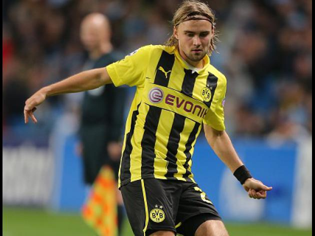 Dortmund go top after beating Real