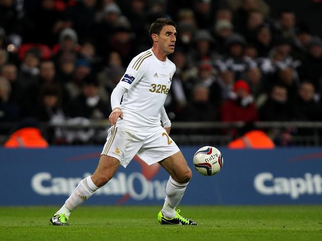 Angel Rangel extends Swansea City stay after signing new deal