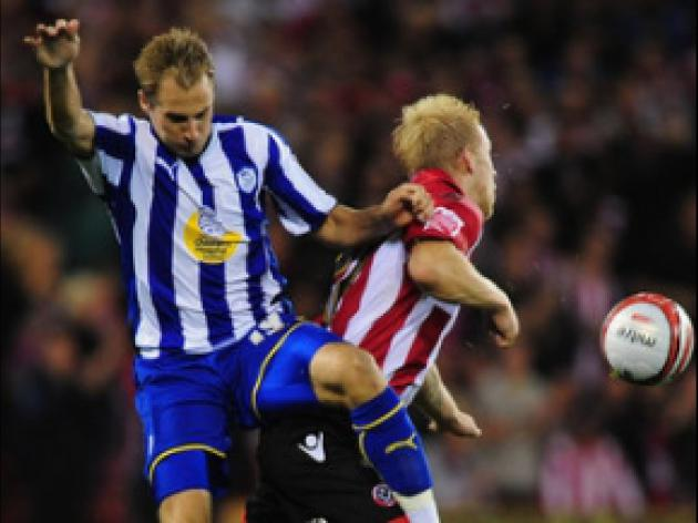 Davies blow adds to Blades' gloom