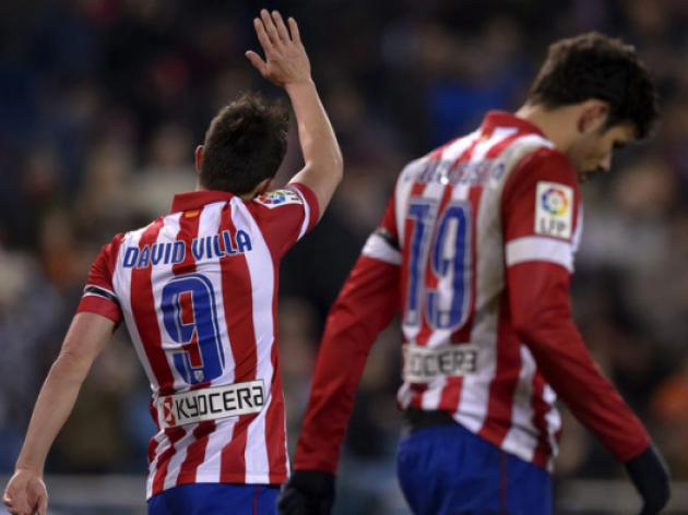 Atletico hit Sociedad for four, go top of La Liga