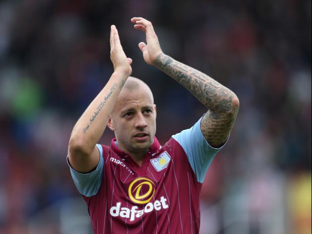 Hutton pens new Villa contract