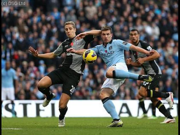 Late Dzeko strike sinks Spurs