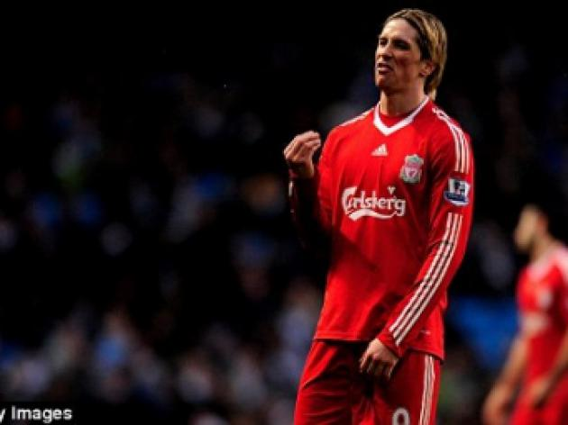 Benitez refuses to rush Liverpool striker Torres into European return