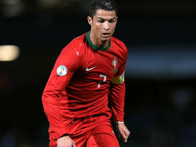Ronaldo heads team into narrow lead