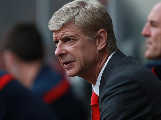 Wenger happy to break at the top