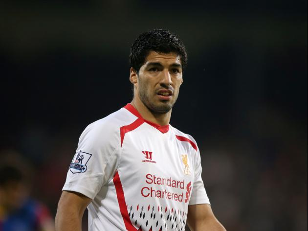 Luis Suarez WILL be back in England this summer... with Barcelona due to train at St George's Park