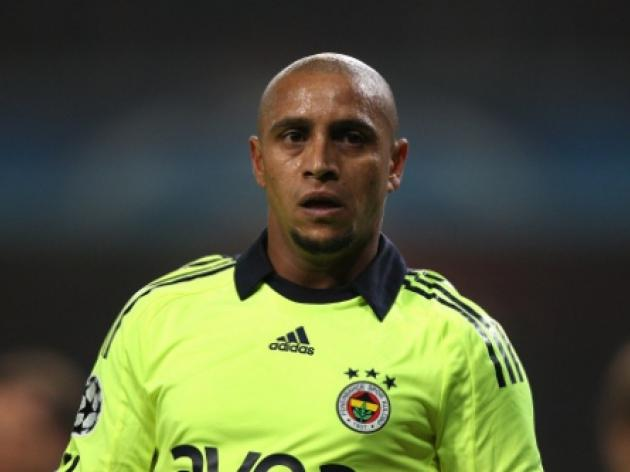 Brazils Roberto Carlos hangs up his boots