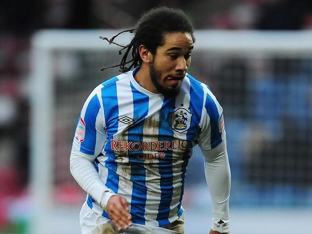 Huddersfield set up Wigan cup clash after seeing off Leicester