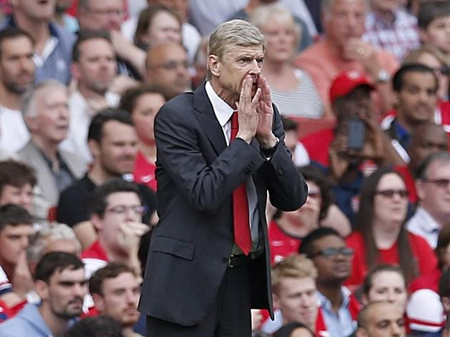 Wenger left with injury headache