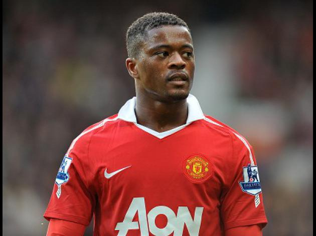 Evra admits he was under pressure over Suarez handshake