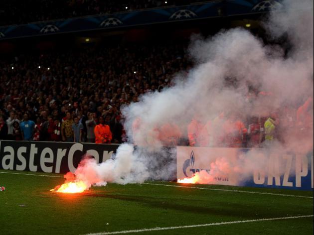 Gala fans throw flares at Emirates